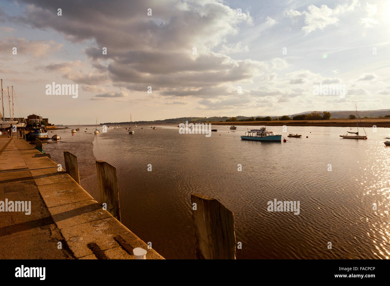 A collection of yachts and motor boats moored in the River Exe at Topsham, Devon, England, UK - Stock Image