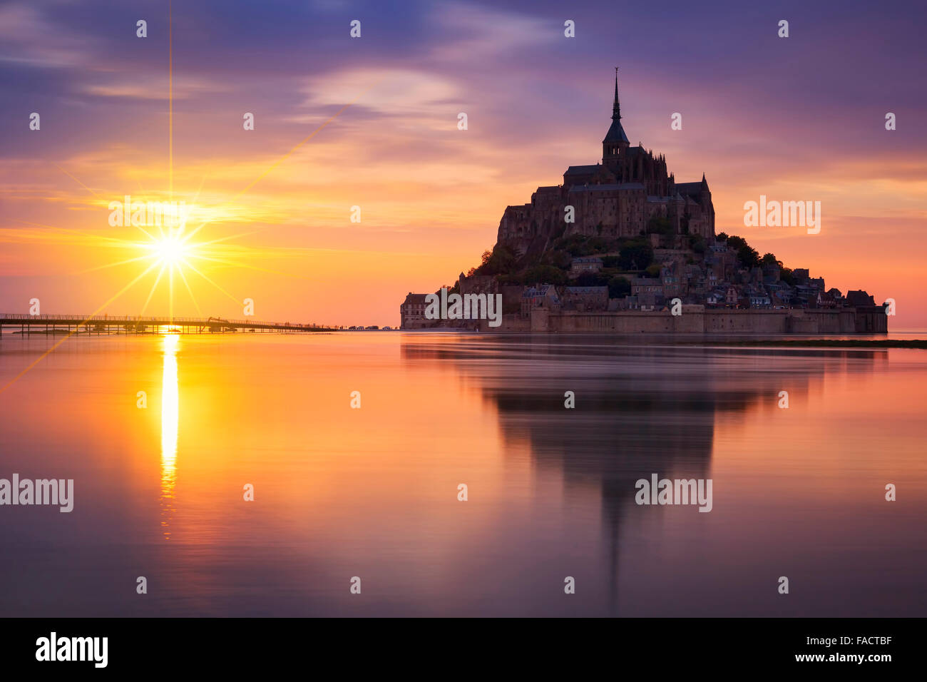 View of famous Mont-Saint-Michel at sunset, France. - Stock Image