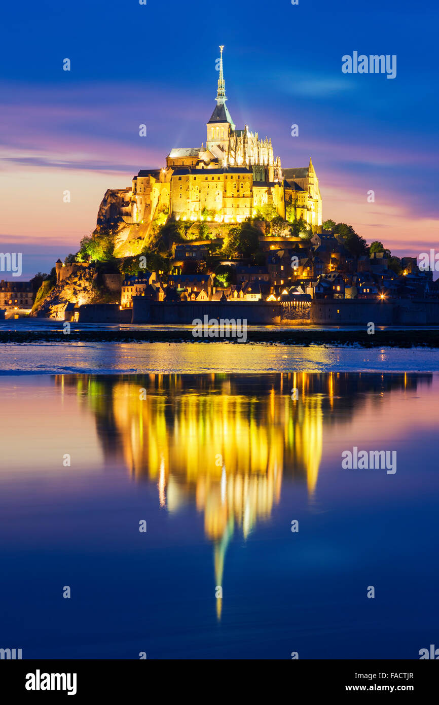 View of famous Mont-Saint-Michel by night, France. - Stock Image