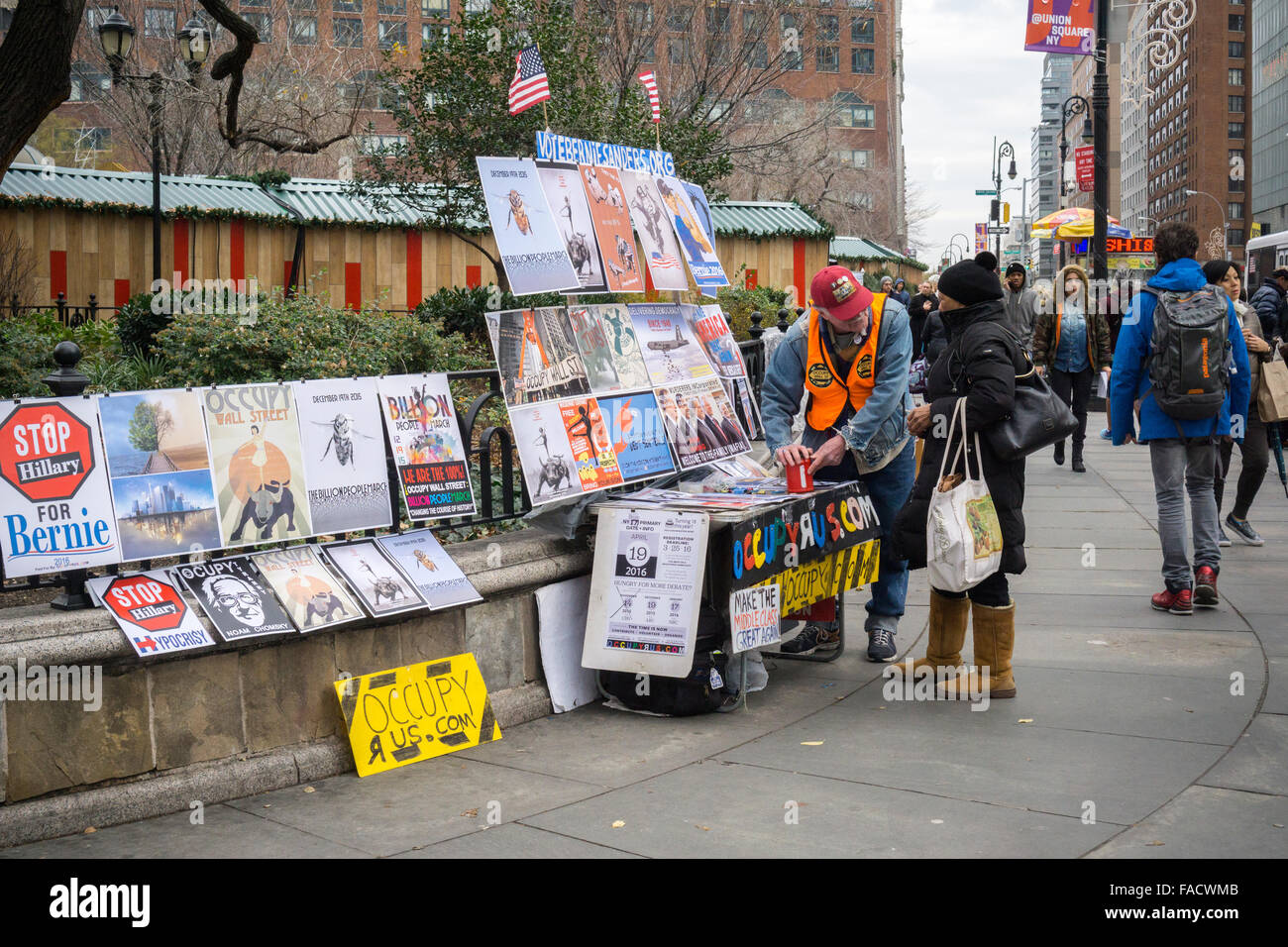 A supporter of US Presidential candidate Bernie Sanders sells Sanders related ephemera in Union Square in New York Stock Photo