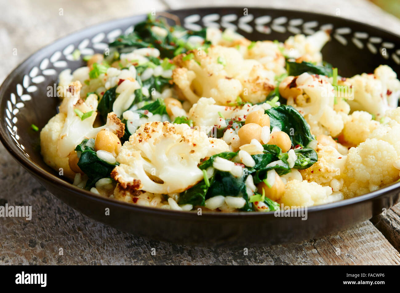Roasted Cauliflower Risotto with Spinach and ChickpeasStock Photo