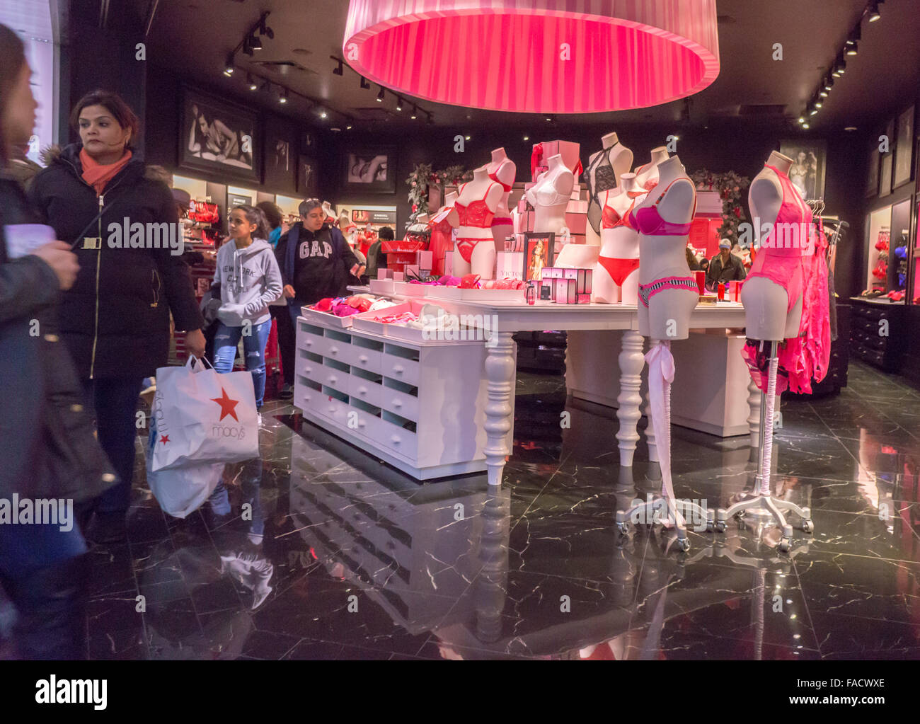 dcd944f950 Shoppers in the Victoria s Secret store in the Queens Center Mall in the  borough of Queens in New York on the so-called Super Saturday