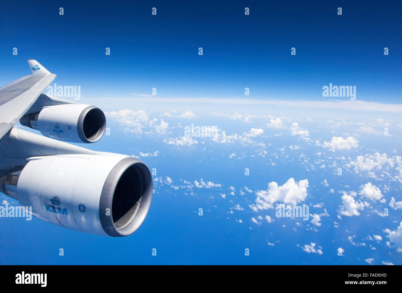 An Airplane Wing an engines During a Flight - Stock Image