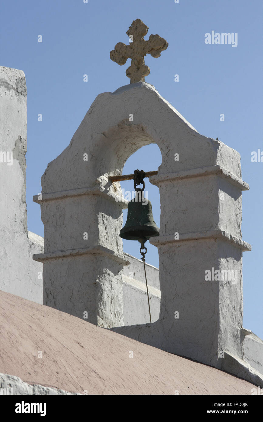 Traditional church in Greece with a bell on a blue sky - Stock Image