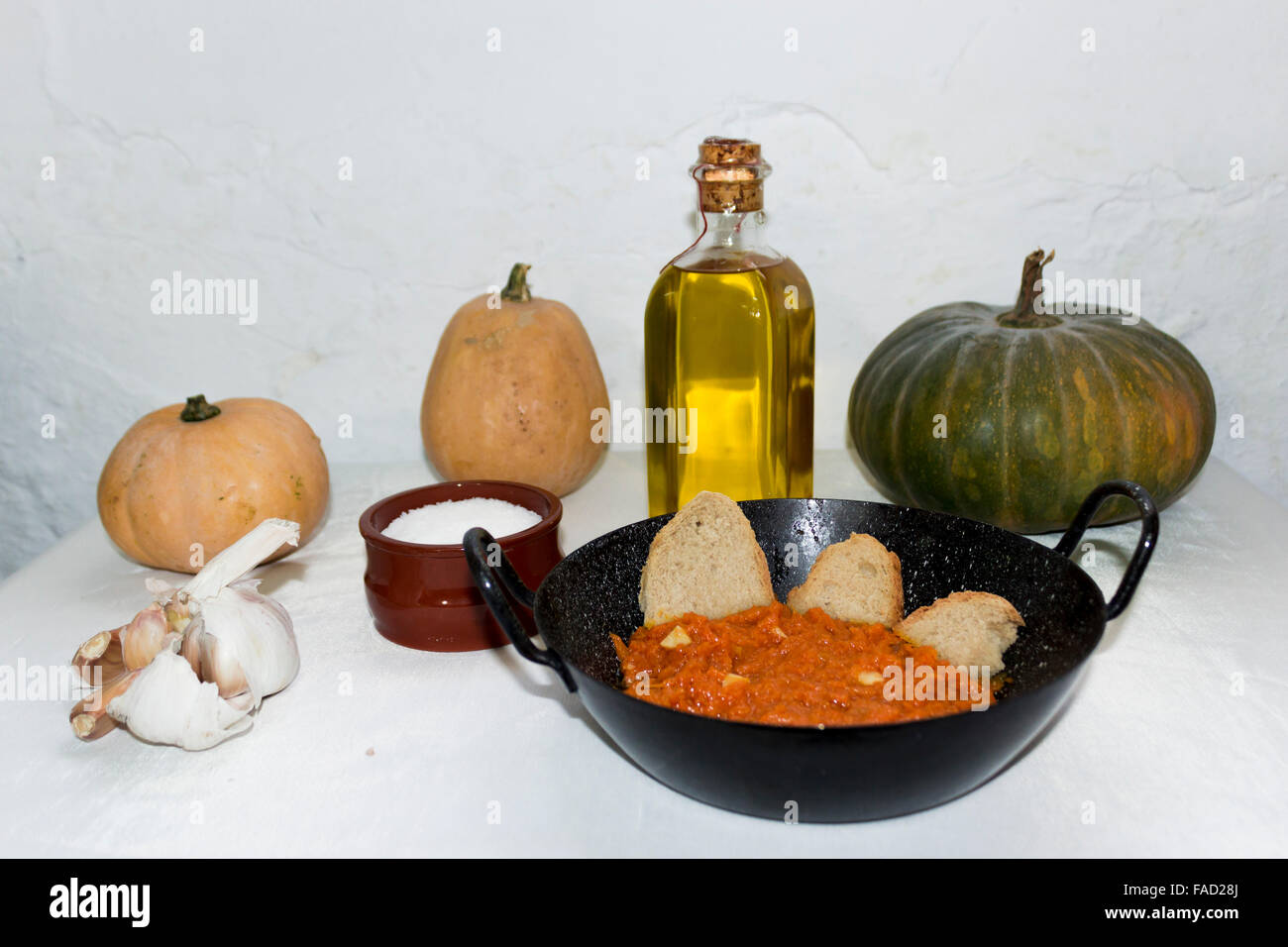 Typical Spanish tapa of pureed pumpkin and bread. - Stock Image