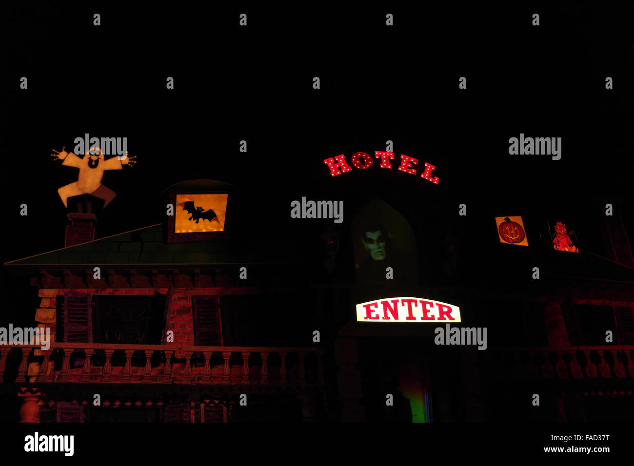 Night view illuminated brown facade Haunted Hotel Tableau with Dracula Head image, The Cliffs, Blackpool Illuminations, - Stock Image