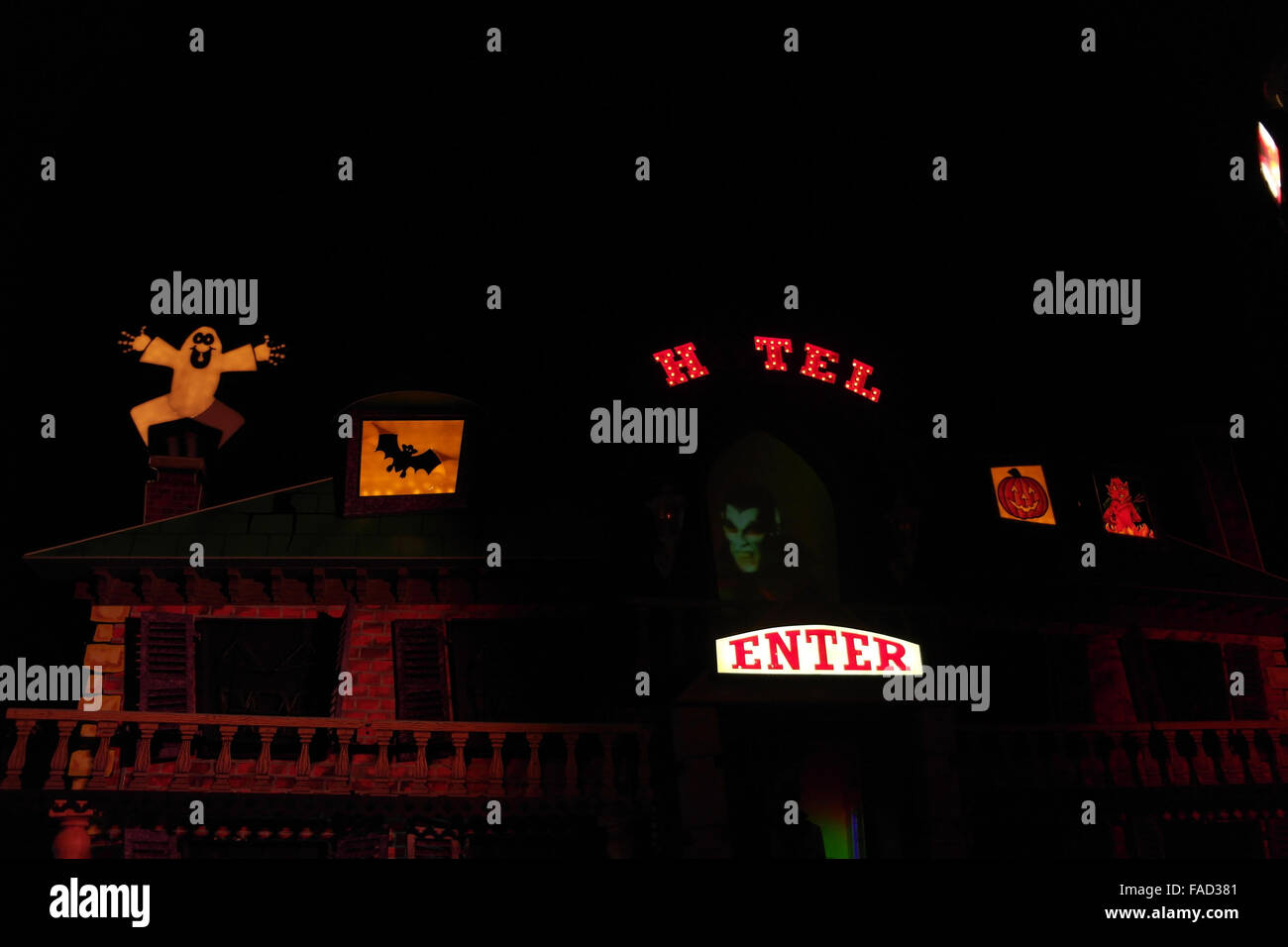 Night view brown illuminated facade Haunted Hotel Tableau with holographic Dracula Head, The Cliffs, Blackpool Illuminations, - Stock Image