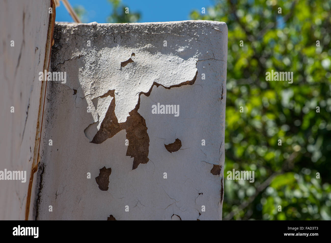 Paint peeling off an outside wall - Stock Image