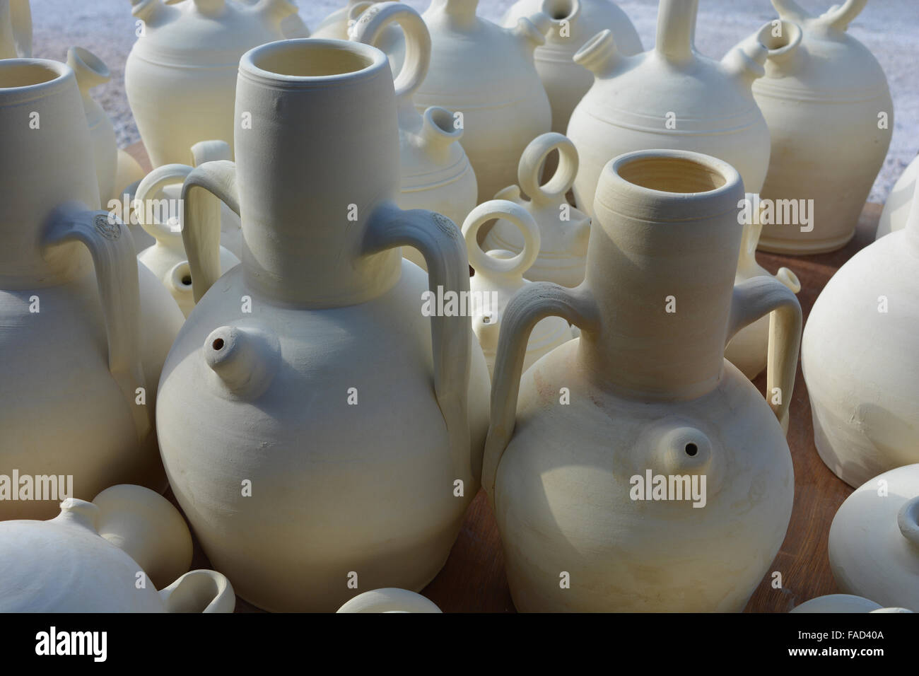 traditional spanish unglazed pottery for sale at a souvenir shop