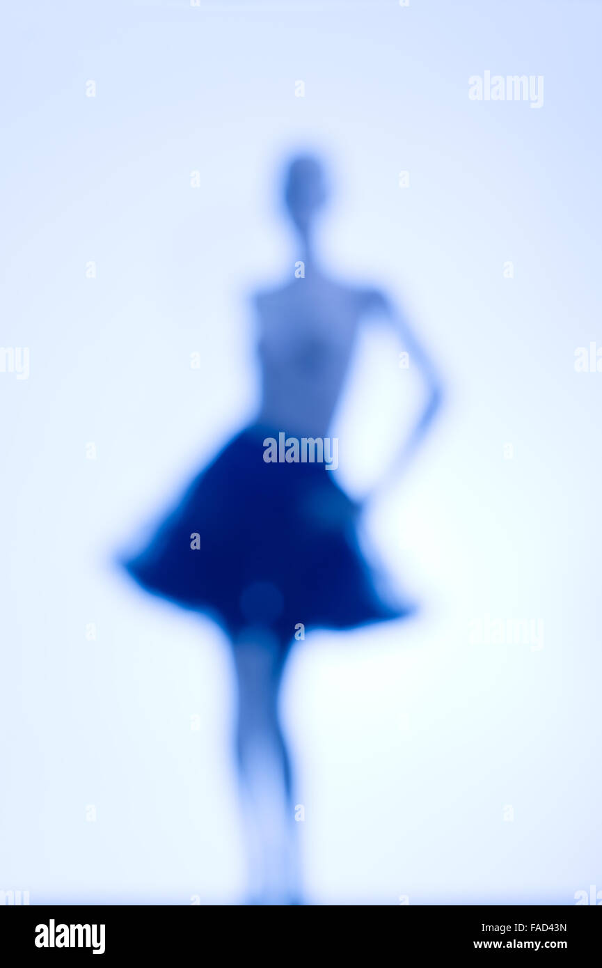 Conceptual image of female identity and femininity: A highly de-focused blurred fuzzy unclear image of a the silhouetted - Stock Image