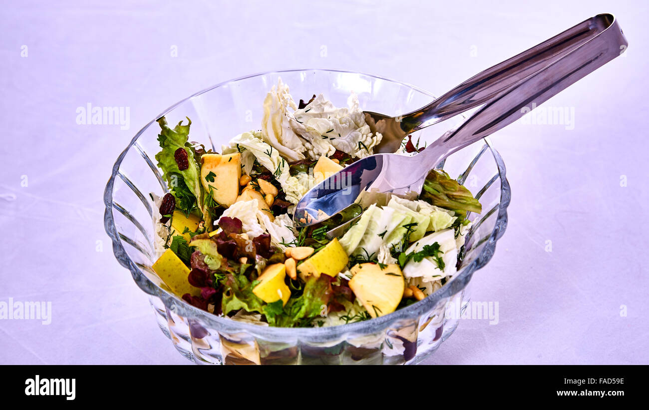 Salad with pears, nuts and greens Stock Photo
