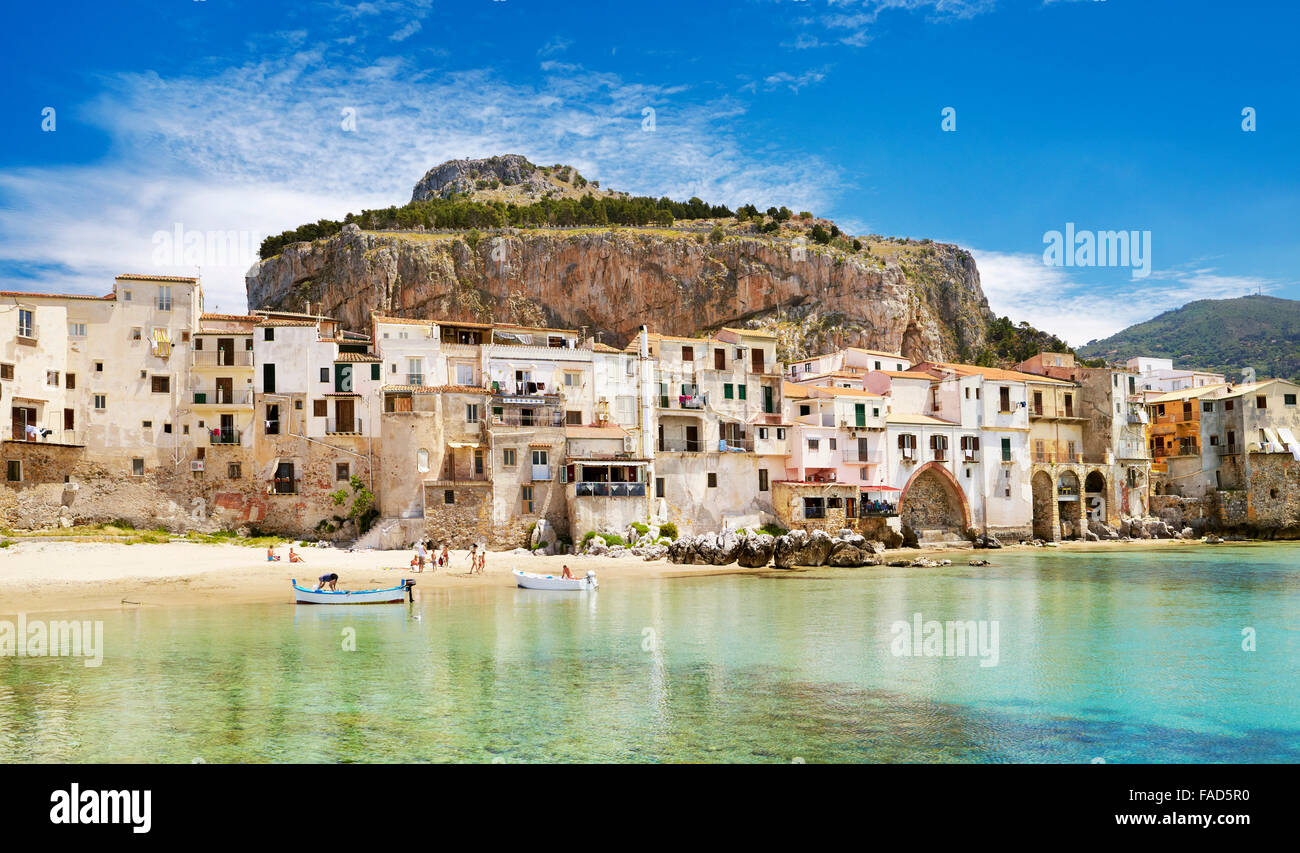 Sicily Island - Medieval houses and La Rocca Hill, Cefalu, Italy - Stock Image