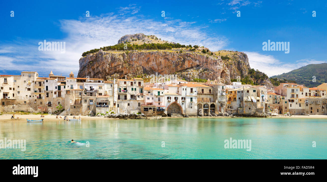 Medieval houses and La Rocca hill, panoramic view, Cefalu old town,  Sicily, Italy Stock Photo