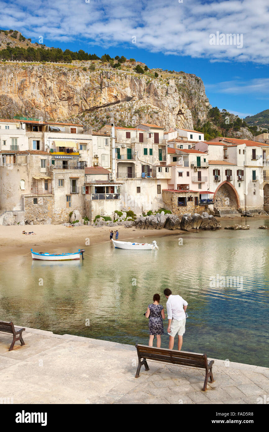 Medieval houses and La Rocca hill, Cefalu Old Town, Sicily, Italy - Stock Image