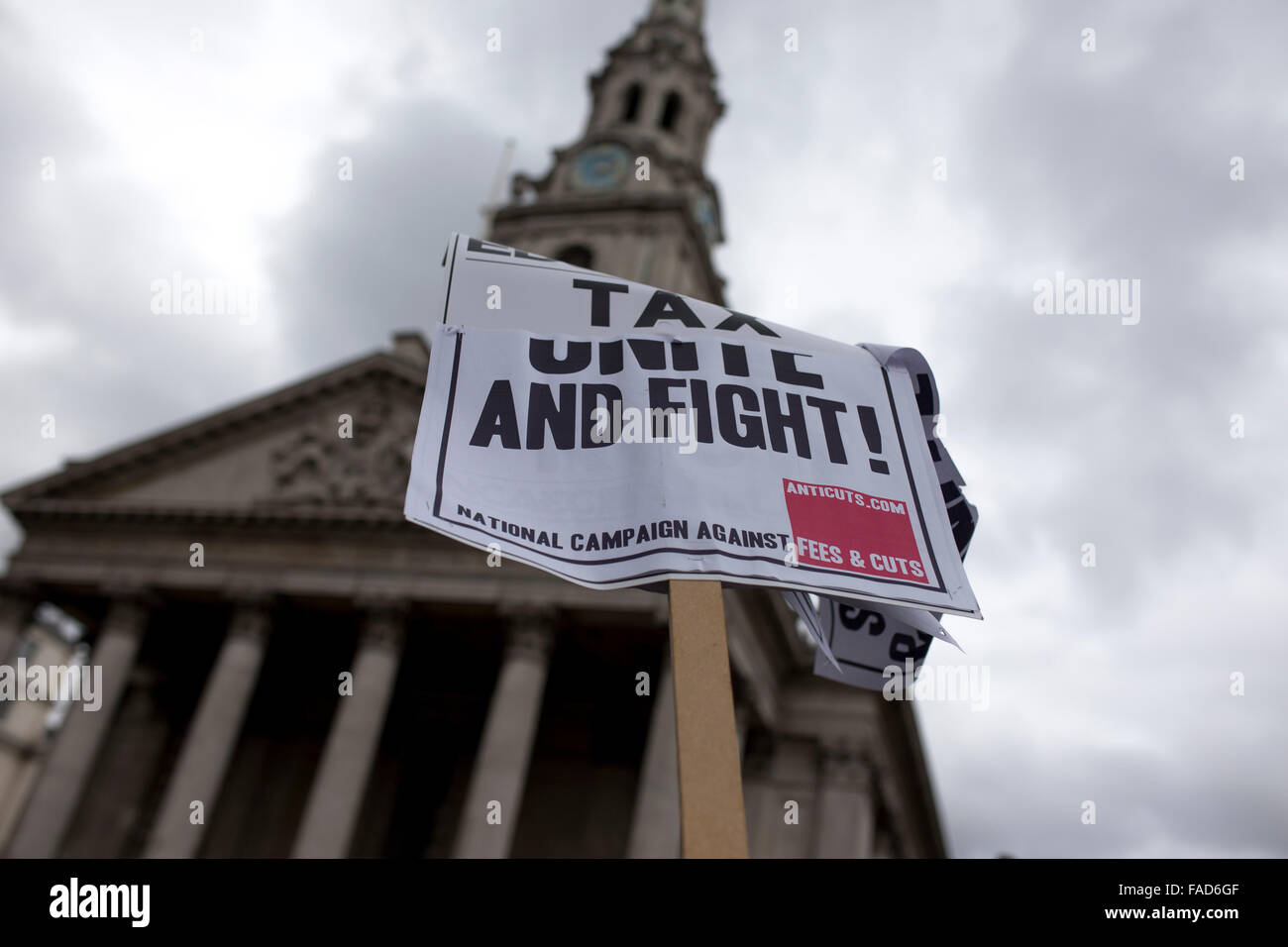 Anti-austerity sign in London with St. Martin-in-the-Fields church in the background. - Stock Image