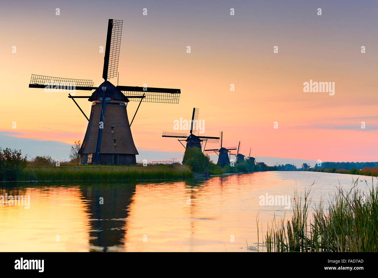 Kinderdijk windmills at sunrise - Holland Netherlands - Stock Image