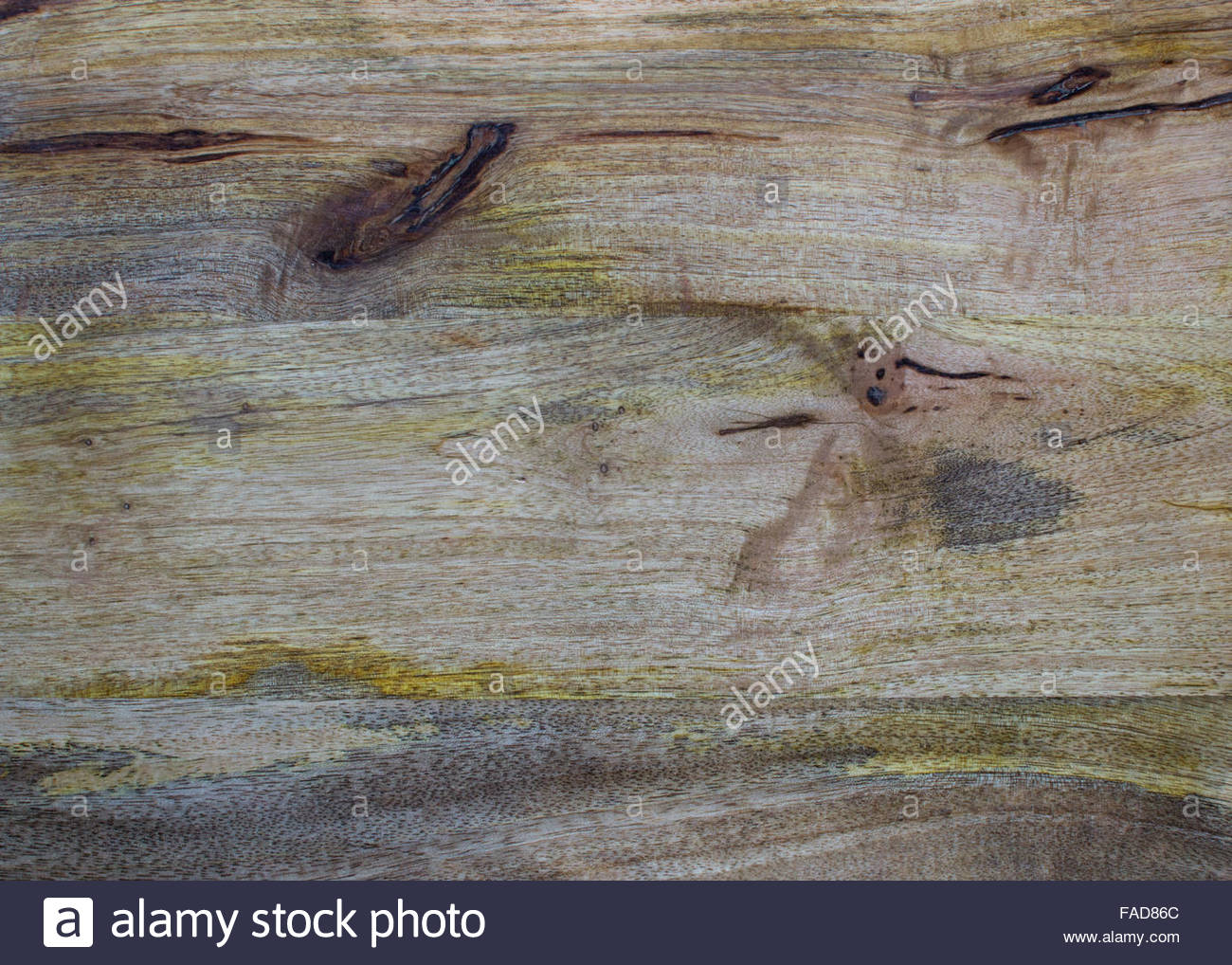 Aged wood  background with yellow and dark brown taint and scratches - Stock Image