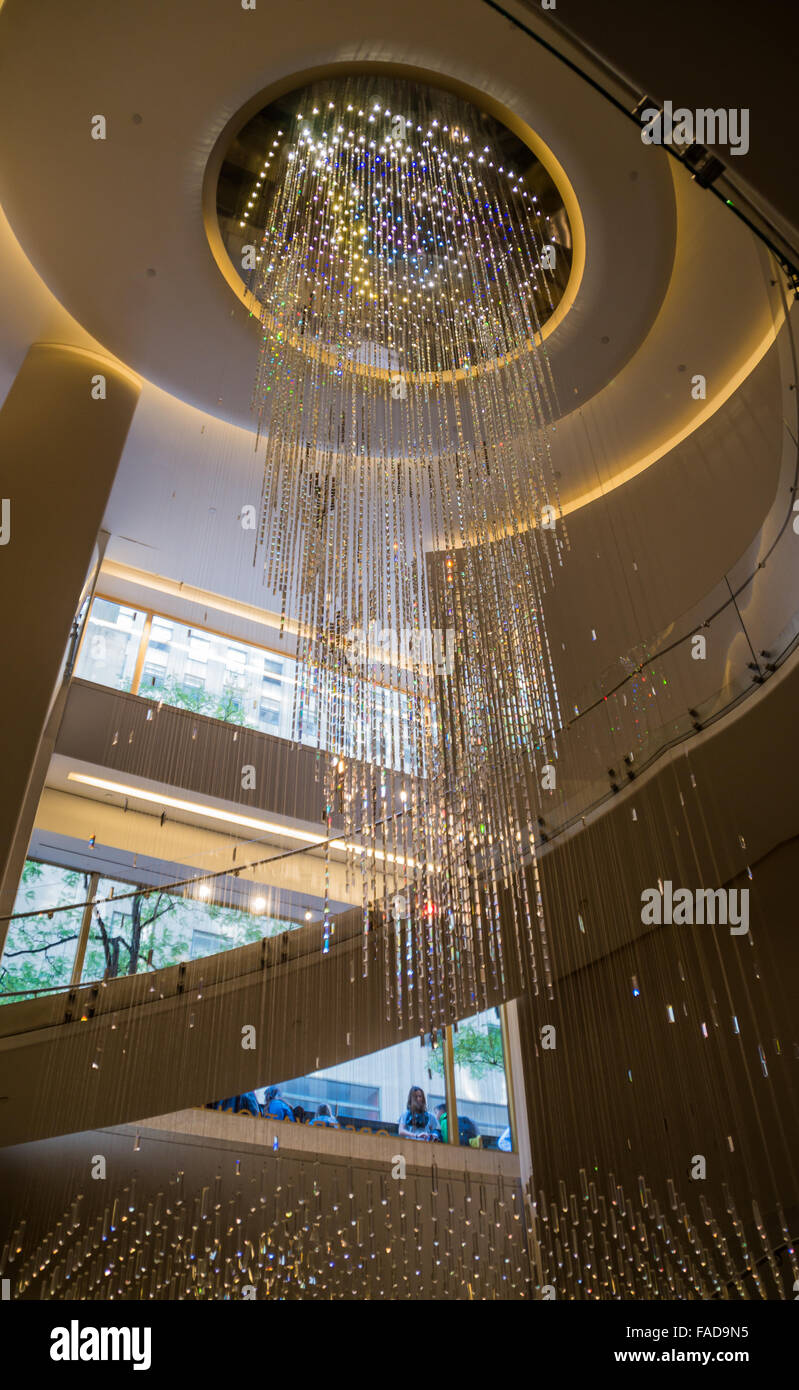 Joie Crystal Water Fall chandelier light fixture and stairs in the Top Of The Rock lobby in the Rockefeller Center Stock Photo