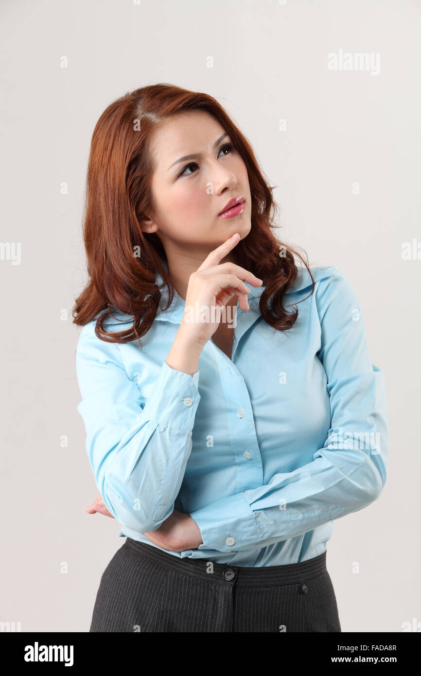 Curious beautiful Woman looking up-contemplation - Stock Image