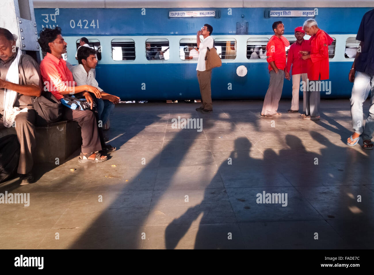 People at Varanasi train station platform. - Stock Image