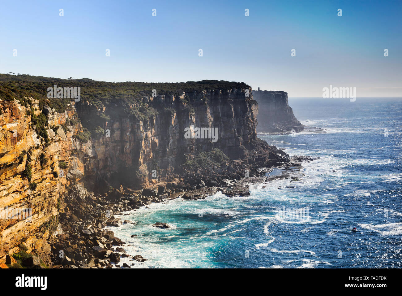 view from elevated lookout from north head in Sydney, Australia, towards rugged rocky coast on a sunny summer day - Stock Image