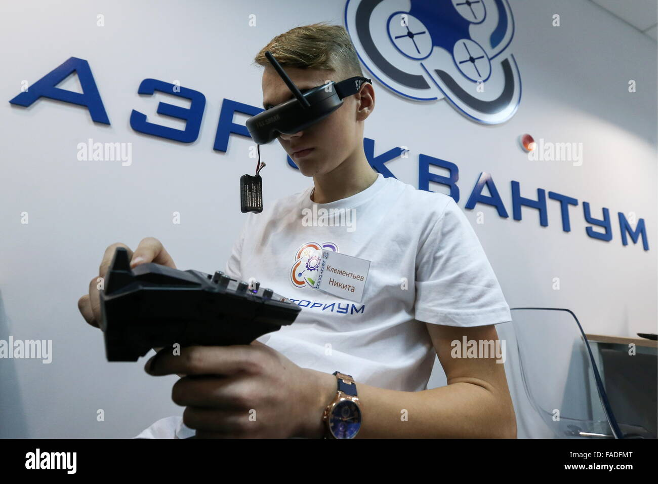 Naberezhnye Chelny, Russia. 27th Dec, 2015. A teenager uses a Fat Shark FPV (first person view) headset to radio - Stock Image