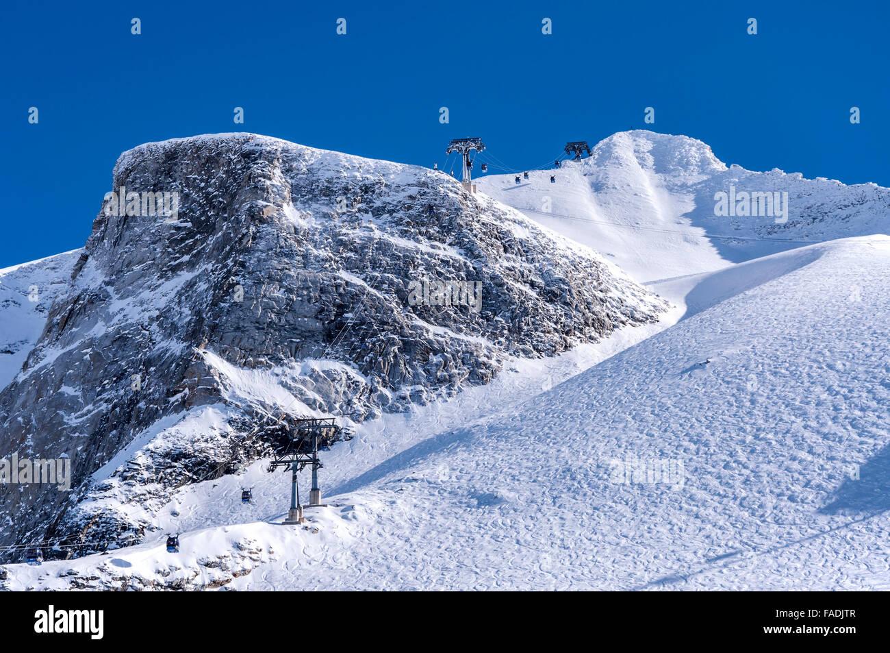 Gondola cable car, rocks and Hintertux Glacier in Zillertal Alps, Tirol, Austria - Stock Image