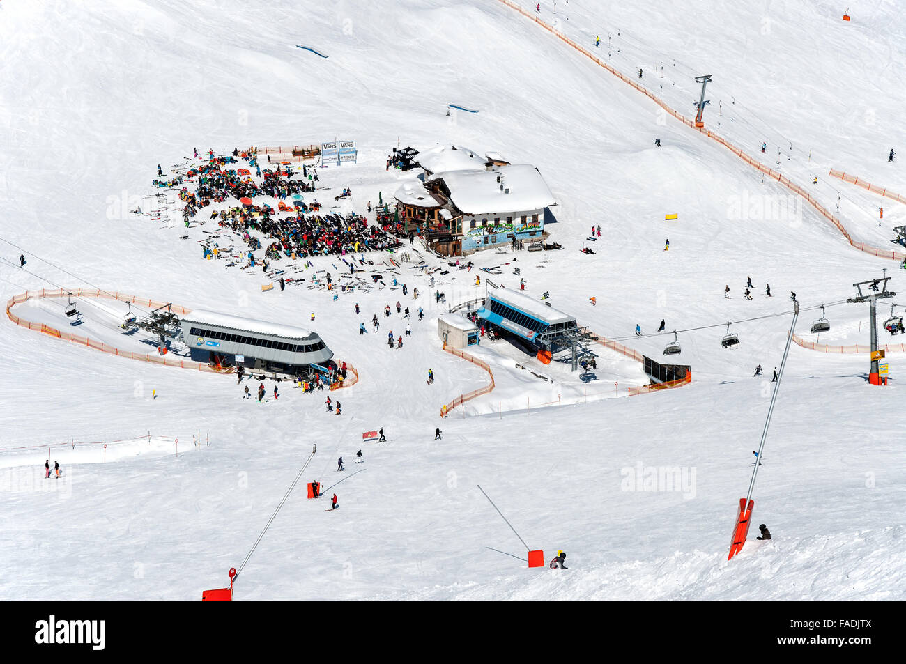 Mayrhofen Ski resort middle station area with ski lifts, pistes and skiers. Zillertal Alps, Tirol, Austria. - Stock Image