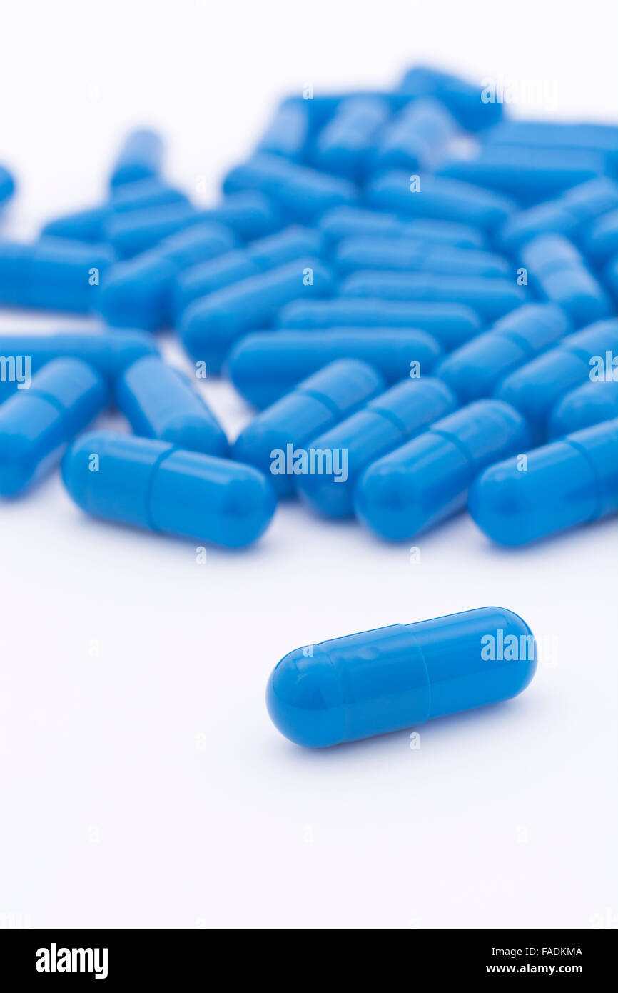 Close-up of blue pills - capsule form made of gelatin. - Stock Image