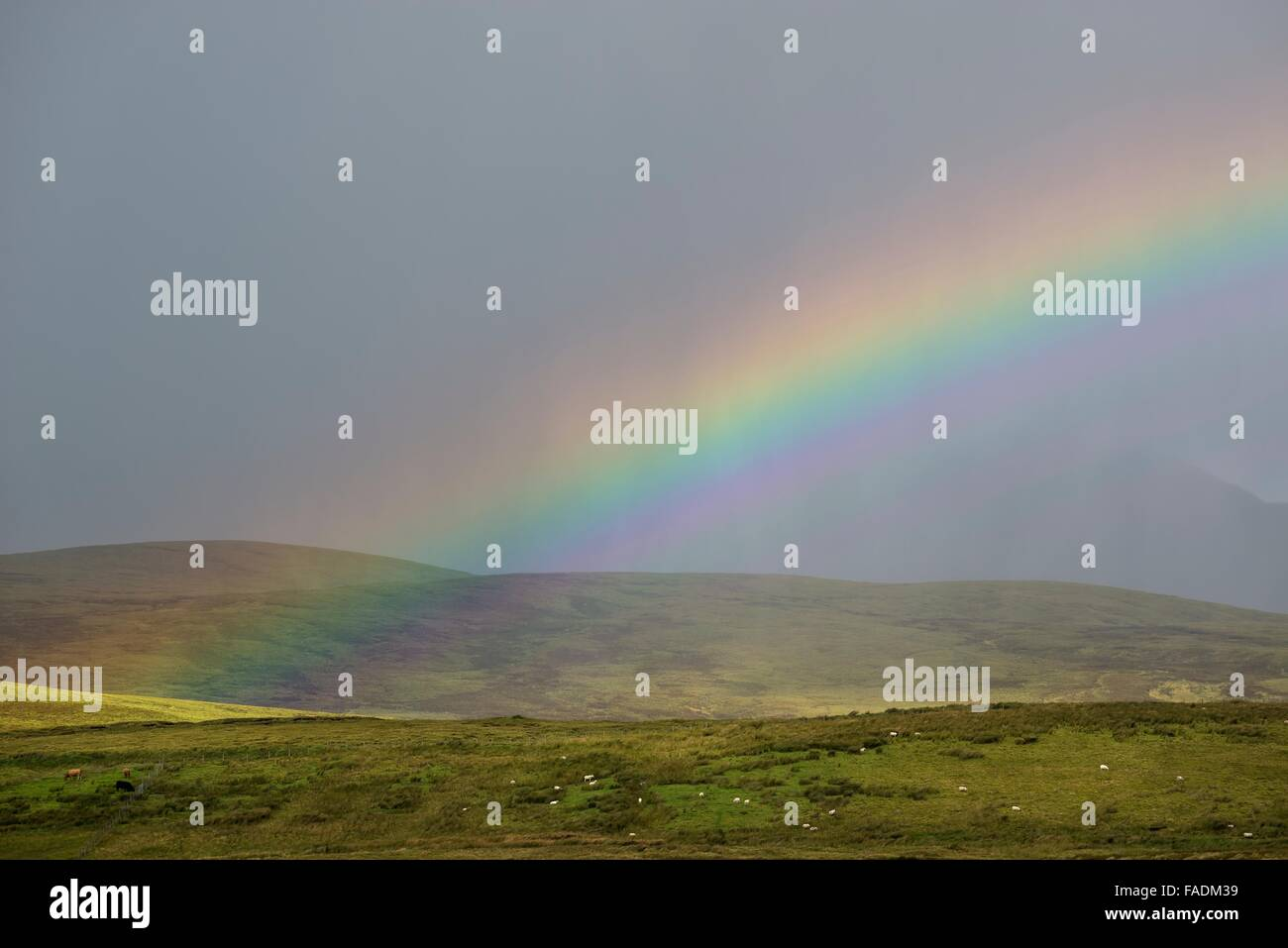 Rainbow in the West Highlands, Staffin, Isle of Skye, Scotland, United Kingdom - Stock Image
