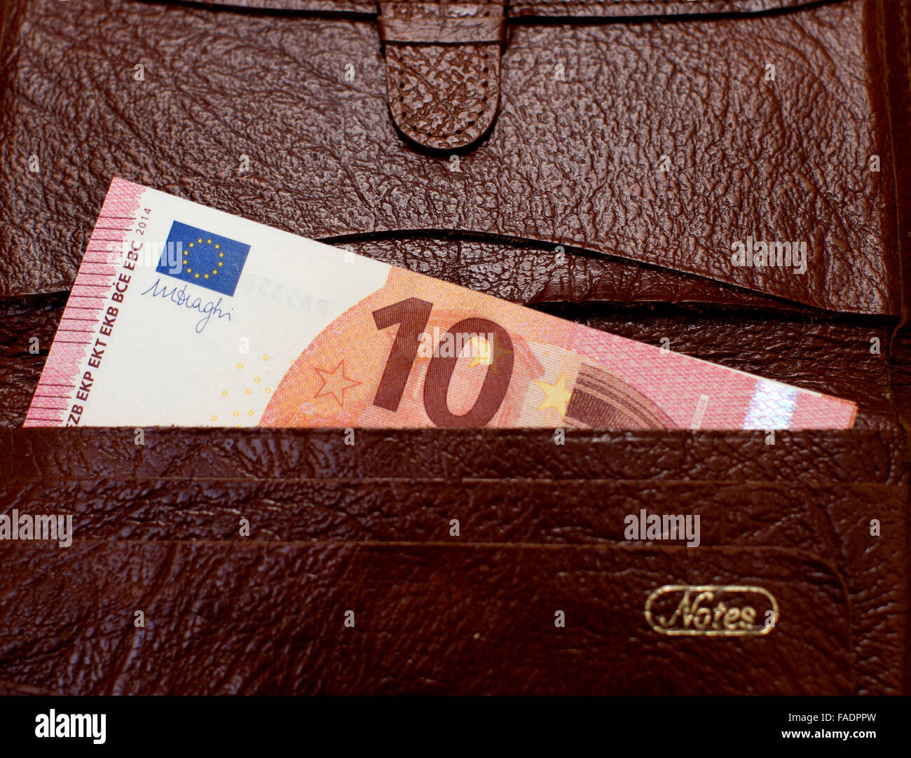 10 Euros banknote in leather wallet, London - Stock Image
