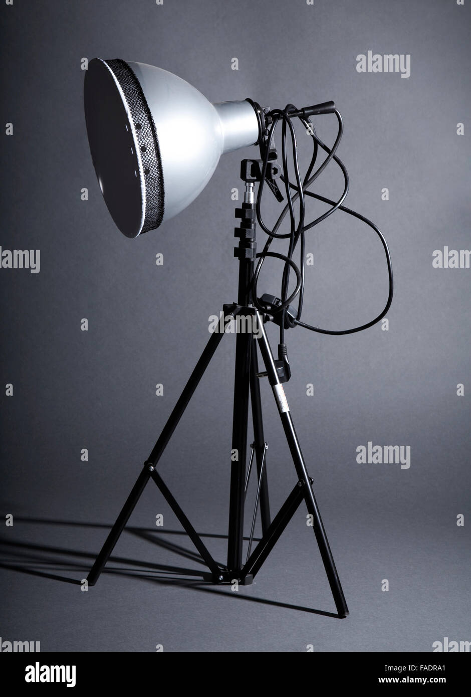 Photographic reflector on a grey background - Stock Image