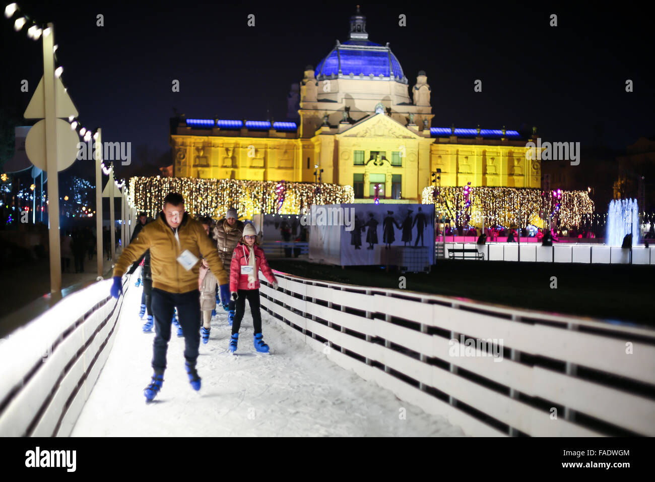 People skating in the city ice skating rink at Advent time in King Tomislav Park in Zagreb, Croat Stock Photo