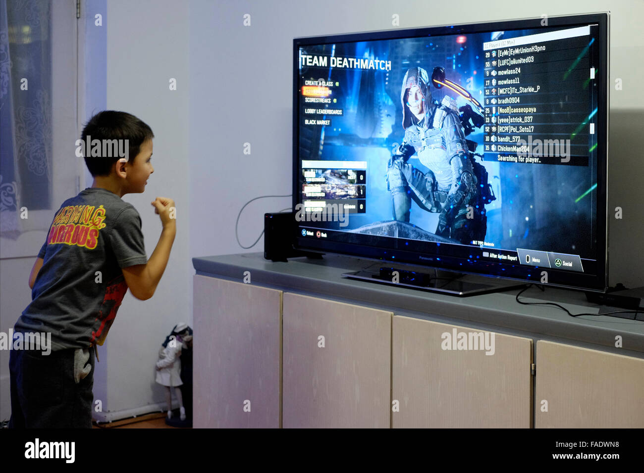 young boy playing vi