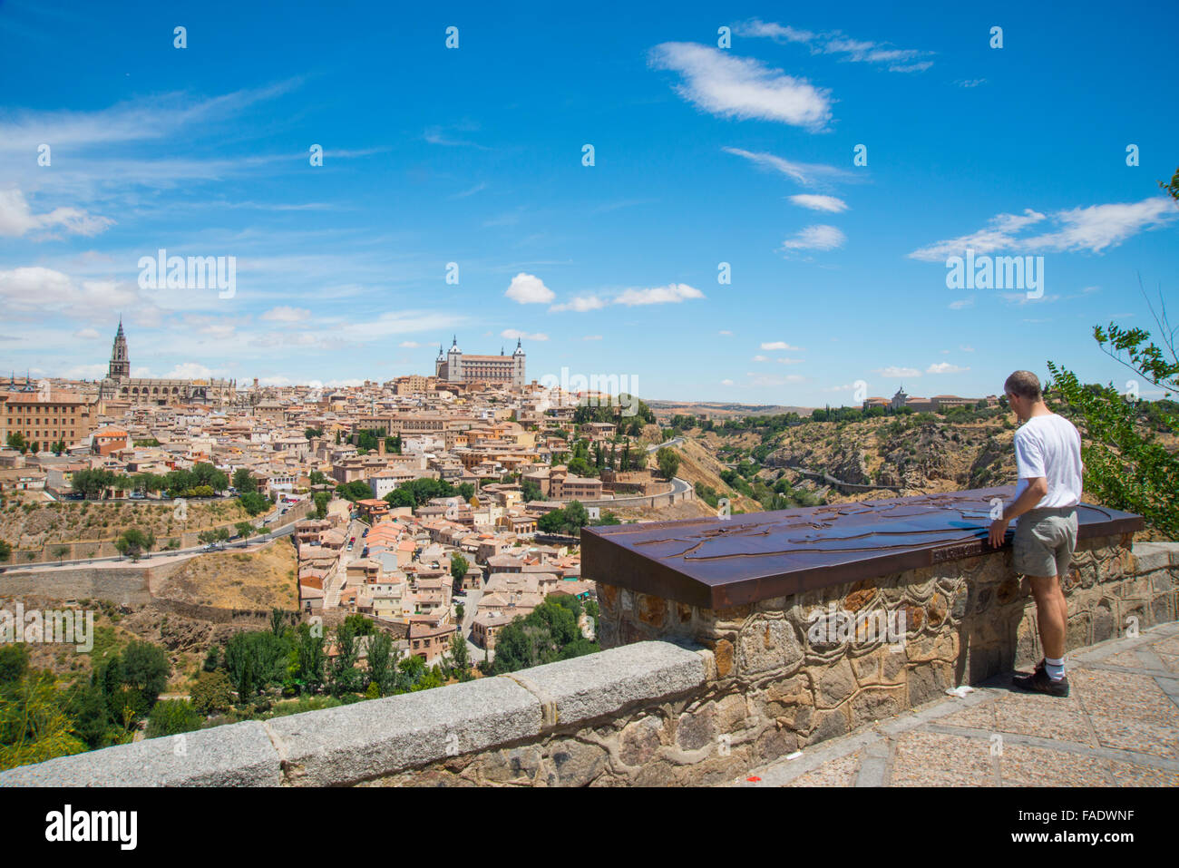 Man at the viewpoint and overview of the town. Toledo, Spain. - Stock Image