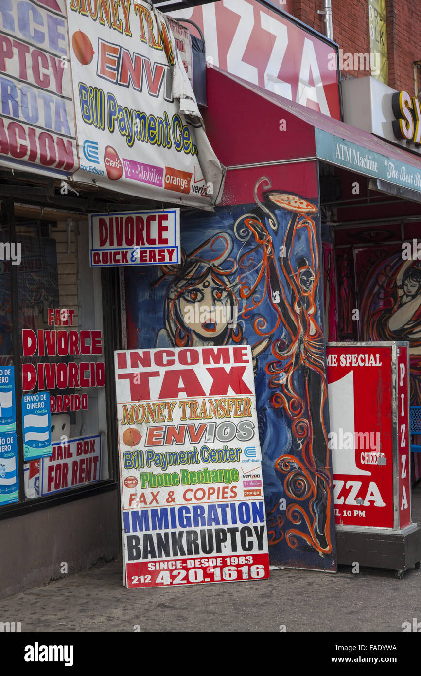 Storefront advertising everything from quick divorce to income tax and bankrupcy help on Essex Street on the Lower - Stock Image
