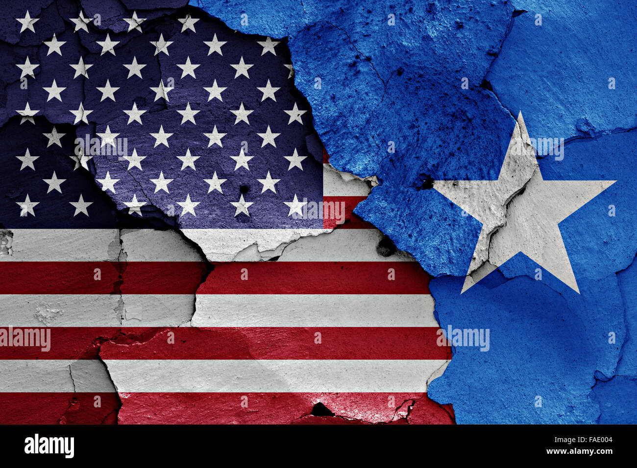 flags of USA and Somalia painted on cracked wall - Stock Image