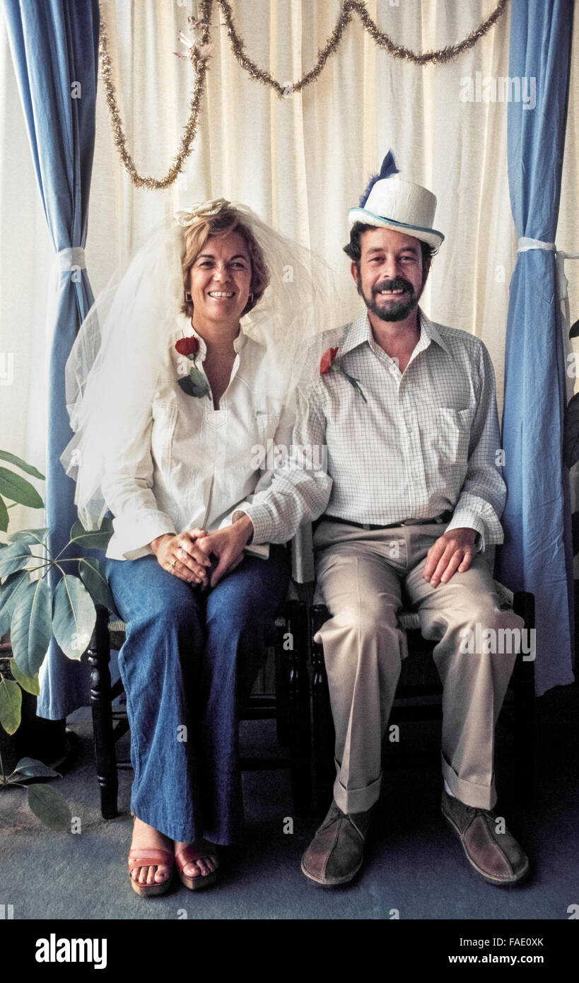A hippie couple proudly poses for a portrait prior to their wedding ceremony in 1976 in Laguna Beach, California, - Stock Image