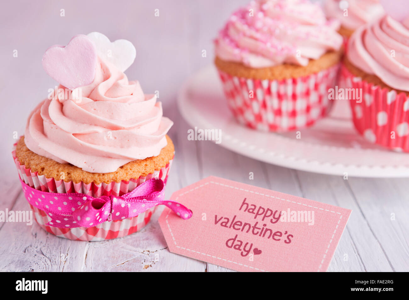 Pink Valentine Cupcakes With The Words Happy Valentine S Day On A