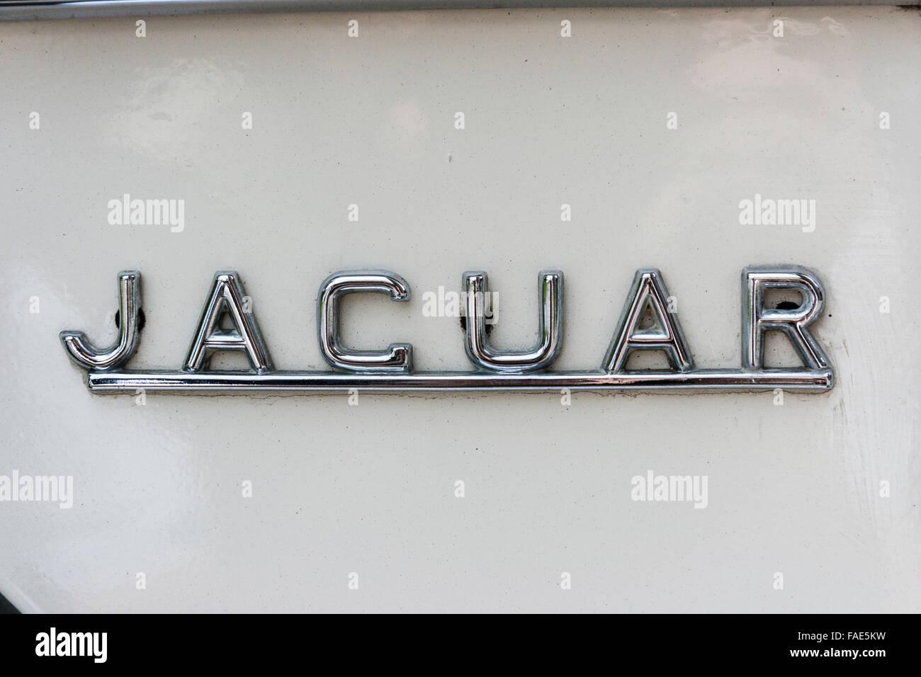 England. British classic car, Jaguar XJ 4.2c silver name badge logo ...