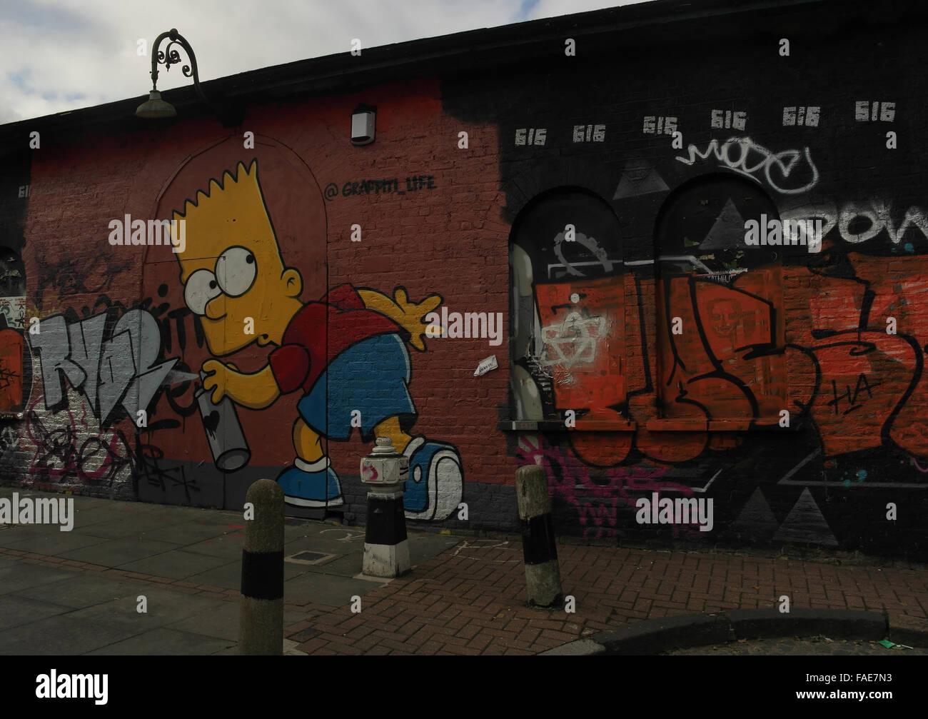 Oblique view Graffiti Life image of Bart Simpson holding spray can next to scrawl, Pedley Street off Brick Lane, Stock Photo