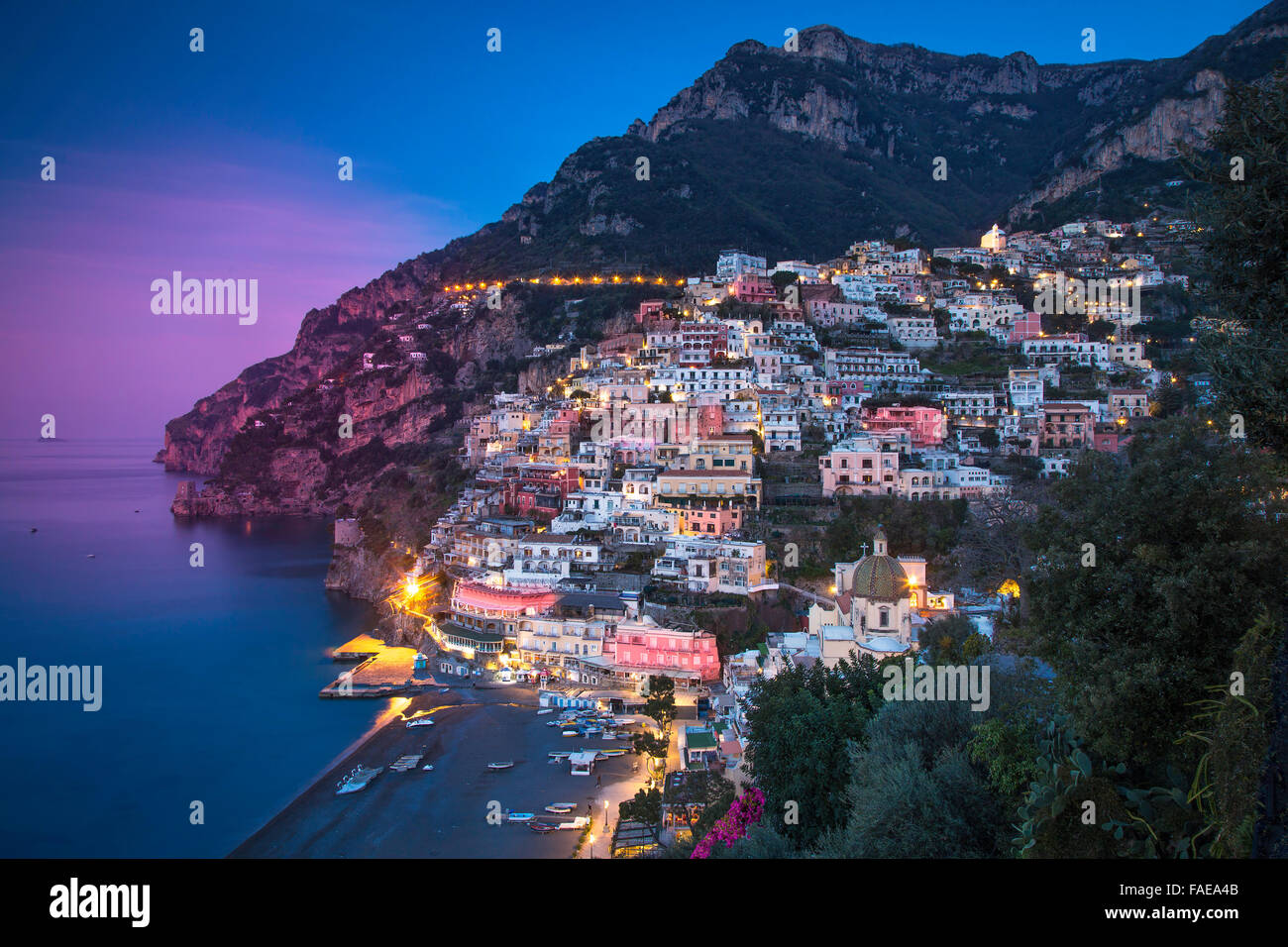 Evening view along the Amalfi coast of the hillside town of Positano, Campania, Italy - Stock Image
