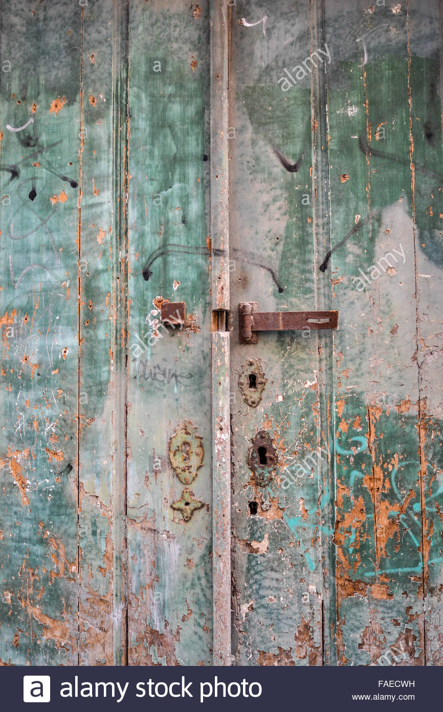 Old wood green doors closed with fade paint - Stock Image
