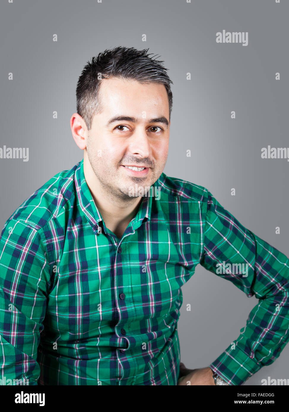 30 year old man casual dressed in studio - Stock Image