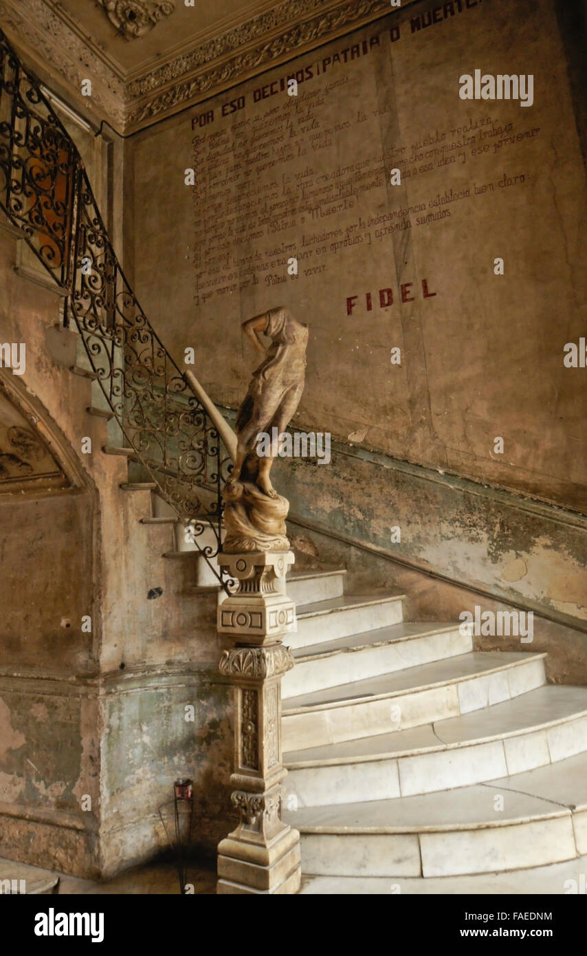 Marble staircase and political poem in lower lobby of La Mansion Camaguey (La Guarida building), Havana, Cuba - Stock Image