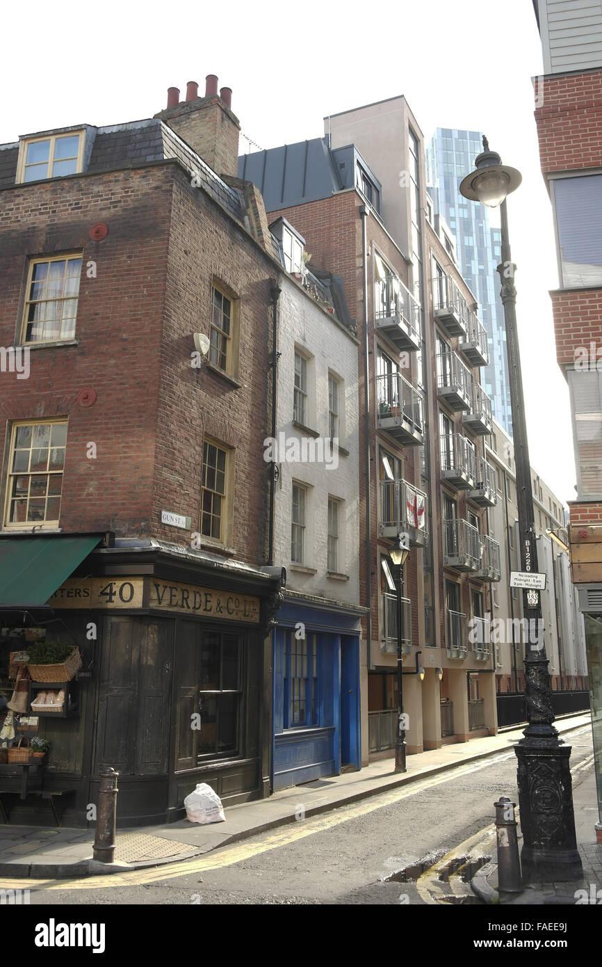 White sky sunny day oblique portrait Gun Street, looking south from Brushfield Street, Spitalfields, London, E1, Stock Photo