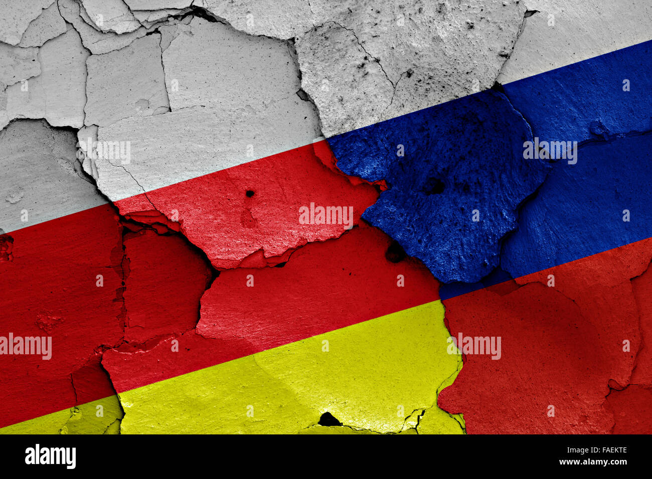 flags of North Ossetia-Alania and Russia painted on cracked wall - Stock Image