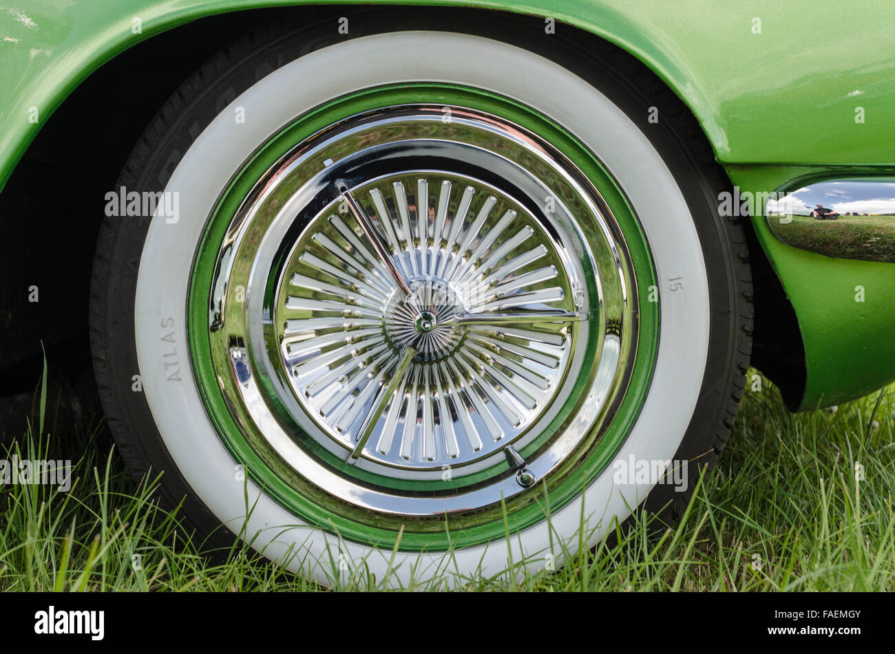 Whitewall tyre on a custom classic car finished in metallic greem with lots of shiny chrome - Stock Image