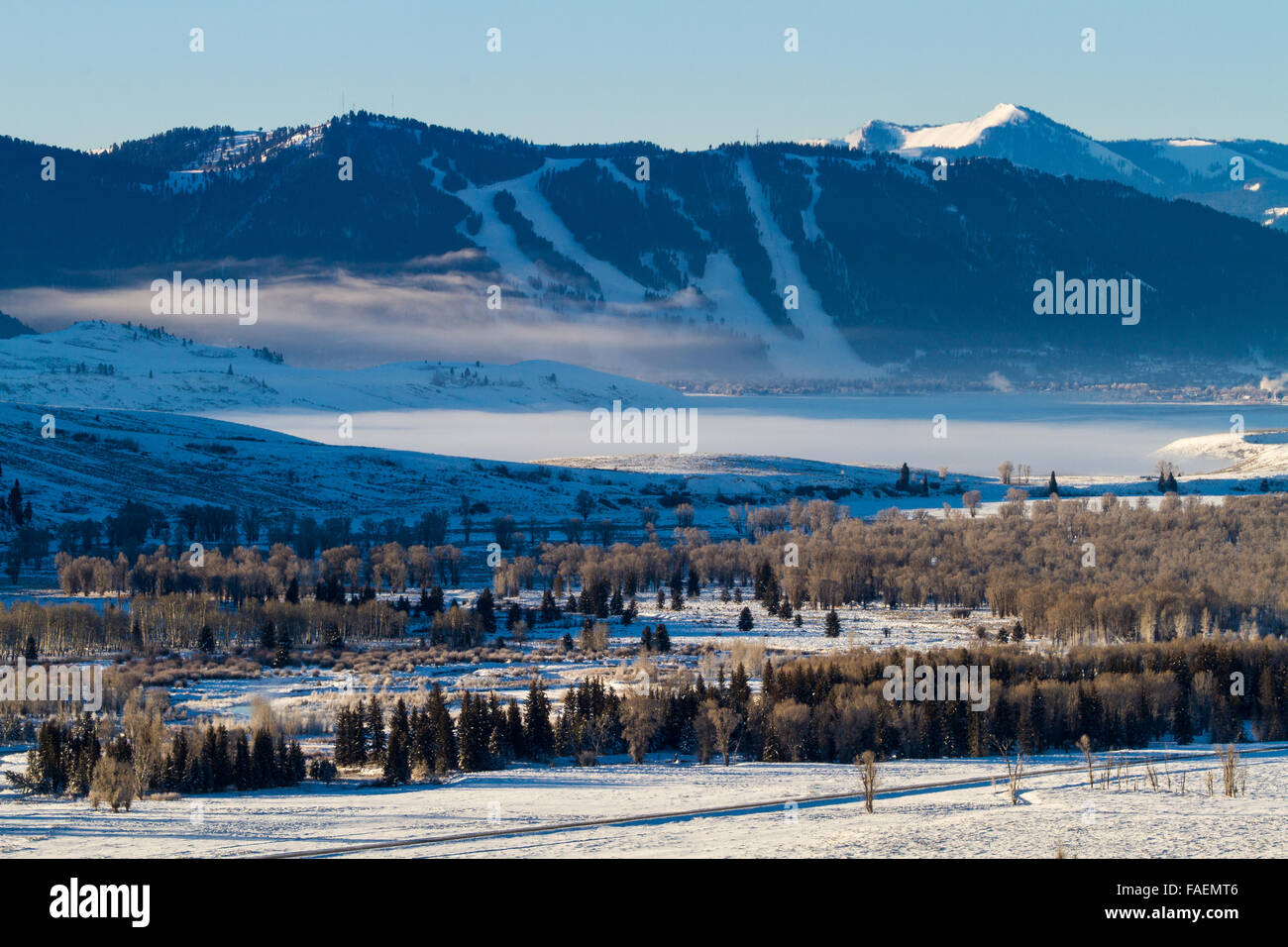 The Snow King Ski Resort towering above Jackson, Wyoming and the National Elk Refuge. - Stock Image