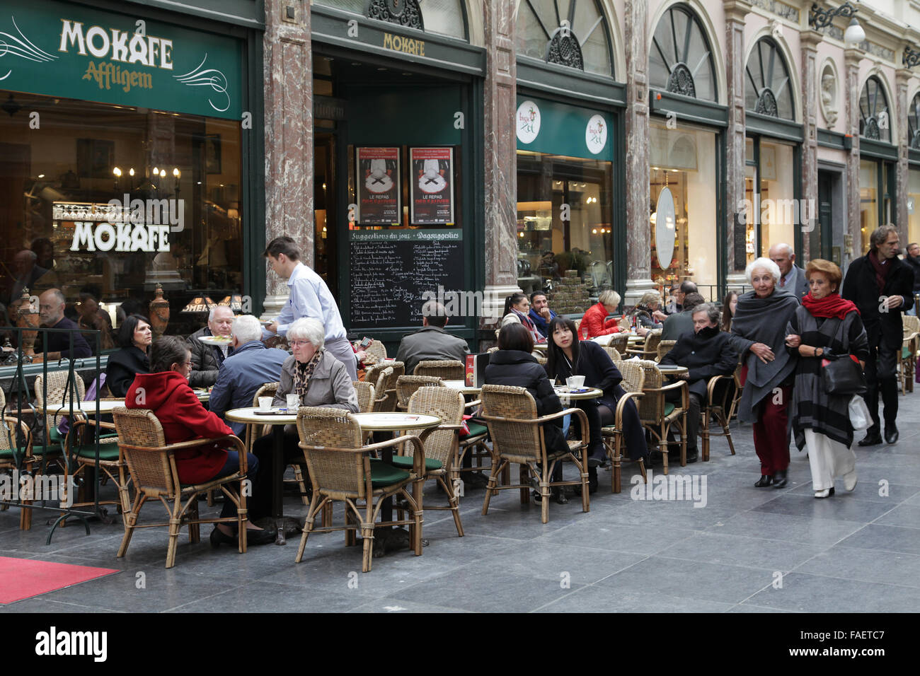 Saint-Hubert arcade.a glazed shopping arcade in Brussels.The Koninklijke Sint-Hubertusgalerijen or Galeries Royales - Stock Image